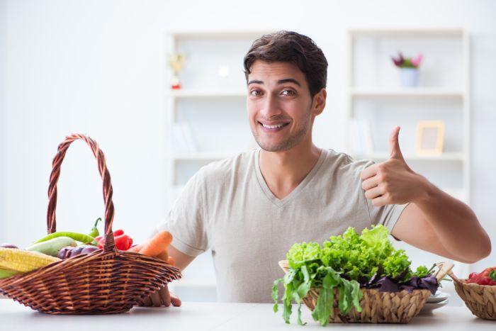 Young man in healthy eating and dieting concept
